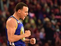 Golden State Warriors guard Stephen Curry (30) celebrates during the 2015 NBA All Star Three Point Contest competition at Barclays Center. Mandatory Credit: Bob Donnan-USA TODAY Sports
