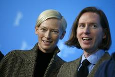 """Actress Tilda Swinton and director Wes Anderson pose during a photocall to promote the movie """"The Grand Budapest Hotel"""" at the 64th Berlinale International Film Festival in Berlin February 6, 2014.  REUTERS/Thomas Peter"""