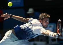 Stan Wawrinka of Switzerland stretches to hit a return to Jarkko Nieminen of Finland during their men's singles third round match at the Australian Open 2015 tennis tournament in Melbourne January 24, 2015.  REUTERS/Thomas Peter