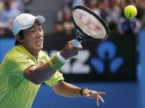 Kei Nishikori of Japan hits a return to Stan Wawrinka of Switzerland during their men's singles quarter-final match at the Australian Open 2015 tennis tournament in Melbourne January 28, 2015.    REUTERS/Thomas Peter