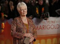 "Actress Judi Dench arrives at the Royal Film Performance and world premiere of the film, ""The Second Best Exotic Marigold Hotel"", at Leicester Square, London February 17, 2015. REUTERS/Peter Nicholls"