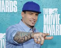 Singer Vanilla Ice, whose real name is Robert VanWinkle, arrives at the 2012 MTV Movie Awards in Los Angeles, in this file photo taken June 3, 2012. REUTERS/Danny Moloshok