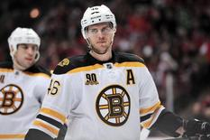 Jan 19, 2014; Chicago, IL, USA; Boston Bruins center David Krejci (46) waits for play to begin against the Chicago Blackhawks during the third period at the United Center. The Blackhawks beat the Bruins 3-2 in the shootout. Mandatory Credit: Rob Grabowski-USA TODAY Sports