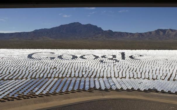 The Google logo is spelled out in heliostats (mirrors that track the sun and reflect the sunlight onto a central receiving point) during a tour of the Ivanpah Solar Electric Generating System in the Mojave Desert near the California-Nevada border February 13, 2014. REUTERS-Steve Marcus