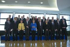 German Chancellor Angela Merkel (center, L) and European Commission President Jean-Claude Juncker (center, R) take part in a group photo with EU commissioners in Brussels March 4, 2015.   REUTERS/Yves Herman