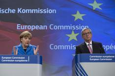 German Chancellor Angela Merkel (L) speaks at a joint news conference with European Commission President Jean-Claude Juncker at the EC headquarters in Brussels March 4, 2015.   REUTERS/Yves Herman