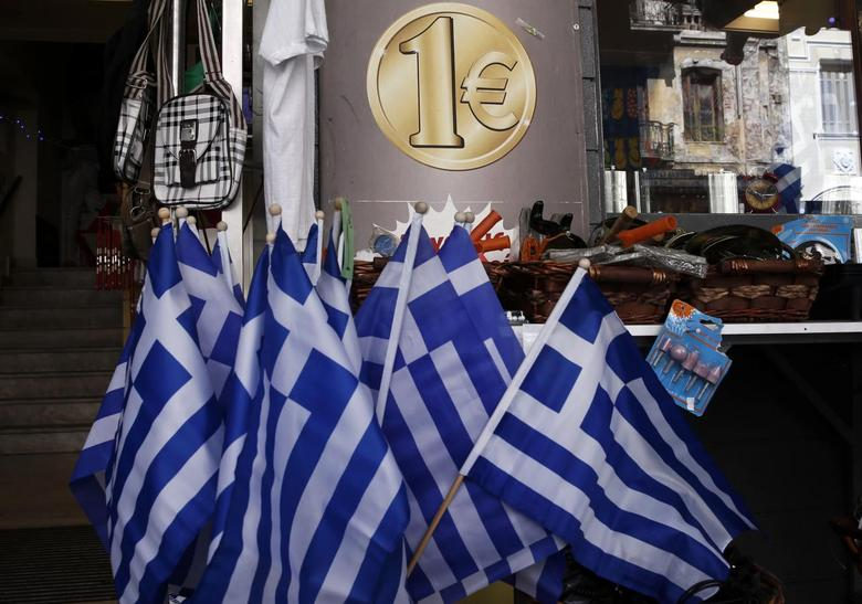 Greek national flags are displayed for sale at the entrance of a one Euro shop in Athens, March 2, 2015. REUTERS/Alkis Konstantinidis