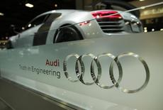 The Audi four rings logo is seen with an 2015 R8 Competition coupe (rear) at the press day for the Washington Auto Show in Washington January 22, 2015.     REUTERS/Gary Cameron