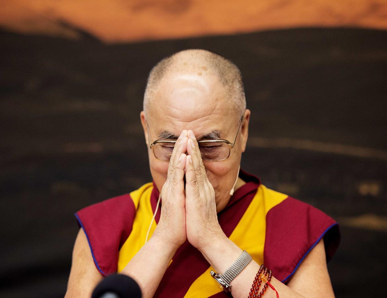 China says Dalai Lama 'profanes' Buddhism by doubting his