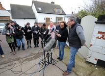 Dee Milligan-Bott (2nd R) co-owner of Irish setter Jagger and her husband Jeremy Bott (R) speak to members of the media outside their home in Kilby, central England March 9, 2015. REUTERS/Stringer