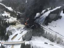 Smoke rises from fires caused by the derailment of a CN Railway train carrying crude oil near the northern Ontario community of Gogama, Ontario in this March 7, 2015 handout photo obtained by Reuters from Transport Safety Board of Canada (TSBCanada) March 9, 2015. REUTERS/TSBCanada/Handout via Reuters
