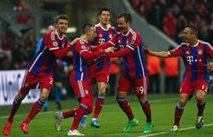 Jogadores do Bayern de Munique comemoram gol contra o Shakhtar Donetsk. 11/03/2015.        REUTERS/Michael Dalder