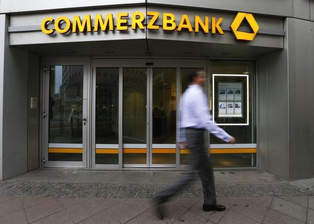 A man walks past a branch of Commerzbank ahead of the bank's annual news conference in Frankfurt February 12, 2015.    REUTERS/Ralph Orlowski