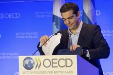 Greek Prime Minister Alexis Tsipras leaves after delivering a speech at the Organisation for Economic Cooperation and Development (OECD) headquarters in Paris March 12, 2015. REUTERS/Philippe Wojazer
