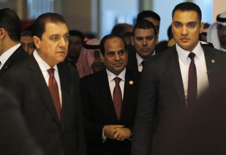 Egypt's President Abdel Fattah al-Sisi (C) arrives for the opening of the Egypt Economic Development Conference (EEDC) in Sharm el-Sheikh, in the South Sinai governorate, about 550 km (342 miles) south of Cairo, March 13, 2015. REUTERS/Amr Abdallah Dalsh