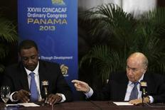 """Joseph """"Sepp"""" Blatter (R) gestures next to  Jeffrey Webb during a news conference at the CONCACAF congress in Panama City April 19, 2013. REUTERS/Carlos Jasso"""