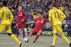 Mar 14, 2015; Columbus, OH, USA; Toronto FC midfielder Sebastian Giovinco (10) shoots the ball in the first half of the game against the Columbus Crew at Mapfre Stadium. Mandatory Credit: Trevor Ruszkowski-USA TODAY Sports