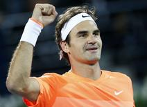 Roger Federer of Switzerland celebrates after winning his final match against Novak Djokovic of Serbia at the ATP Championships tennis tournament in Dubai, February 28, 2015. REUTERS/Ahmed Jadallah