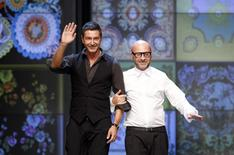 Italian designers Domenico Dolce (R) and Stefano Gabbana acknowledge the applause at the end of D&G Spring/Summer 2012 women's collection show during Milan Fashion Week in this September 22, 2011 file photo. REUTERS/Stefano Rellandini