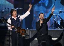 "Paul McCartney (L) and Ringo Starr perform during the taping of ""The Night That Changed America: A GRAMMY Salute To The Beatles"", which commemorates the 50th anniversary of The Beatles appearance on the Ed Sullivan Show, in Los Angeles January 27, 2014.   REUTERS/Mario Anzuoni"