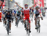Cofidis' cyclist Samuel Dumoulin of France celebrates his victory after crossing the finish line of the seventh and final stage of the Tour of Catalunya cycling race in Barcelona March 27, 2011.REUTERS/Gustau Nacarino