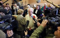 Pierre Le Guennec (R) and his wife Danielle (L)  are surrounded by the media following the verdict of their trial at the courthouse in Grasse, southeastern France, March 20, 2015. REUTERS/Eric Gaillard