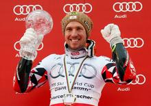 Marcel Hirscher of Austria holds the Globe of the World Cup giant slalom on the podium after the second run of the men's giant slalom race at the Alpine Skiing World Cup Finals in Meribel, in the French Alps, March 21, 2015   REUTERS/Robert Pratta