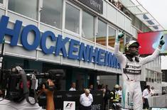 Mercedes Formula One driver Nico Rosberg of Germany celebrates winning the German F1 Grand Prix at the Hockenheim racing circuit July 20, 2014.                 REUTERS/Michael Dalder