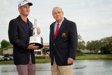 Mar 22, 2015; Orlando, FL, USA; Matt Every (left) celebrates winning the Arnold Palmer Invitational presented by MasterCard while holding the championship trophy and standing next to Arnold Palmer at Bay Hill Club & Lodge. Kevin Liles-USA TODAY Sports