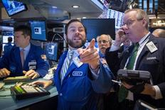 Traders work on the floor of the New York Stock Exchange March 17, 2015. REUTERS/Brendan McDermid
