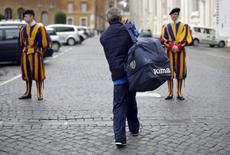 Roberto, an homeless that lives around Vatican, walks to Swiss guards before to enter the Vatican March 26, 2015.  REUTERS/Max Rossi
