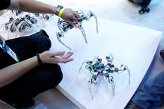 Dancing spider-like robots are displayed at the Intel booth during the 2015 International Consumer Electronics Show in Las Vegas, January 6, 2015.  REUTERS/Steve Marcus