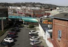 Boeing 737 fuselages are delivered by train to a Boeing manufacturing site in Renton, Washington, February 26, 2014. Jason Redmond