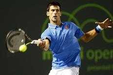 Novak Djokovic hits a forehand against Martin Klizan (not pictured) on day six of the Miami Open at Crandon Park Tennis Center. Mandatory Credit: Geoff Burke-USA TODAY Sports