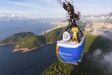 Rio 2016 Olympic mascot Vinicius is seen on the top of the Sugarloaf cable car, to mark 500 days to go until the Opening Ceremony of the 2016 Olympic Games in Rio de Janeiro, in this handout photograph released March 24, 2015. REUTERS/Alex Ferro/Rio 2016/Handout via Reuters