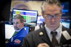 Traders work on the floor of the New York Stock Exchange March 30, 2015. REUTERS/Brendan McDermid