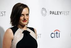 """Cast member Elisabeth Moss poses as she arrives for a panel discussion for the television series """"Mad Men"""" during the The William S. Paley Television Festival at the Dolby theatre in Hollywood, California March 21, 2014.  REUTERS/Mario Anzuoni"""