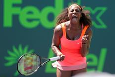 Serena Williams celebrates after winning a point against Sabine Lisicki (not pictured) on day ten of the Miami Open at Crandon Park Tennis Center. Williams won 7-6 (4), 1-6, 6-3. Mandatory Credit: Geoff Burke-USA TODAY Sports