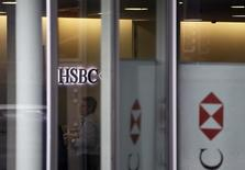 People are seen inside a HSBC Swiss branch of the bank in Geneva February 18, 2015. REUTERS/Pierre Albouy