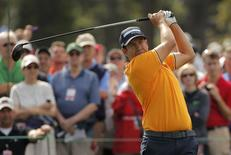 Erik Compton of the U.S. hits off the first tee during his practice round ahead of the 2015 Masters at the Augusta National Golf Course in Augusta, Georgia April 6, 2015.  REUTERS/Brian Snyder
