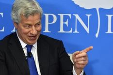 "JPMorgan Chase Chairman and CEO Jamie Dimon speaks during a discussion on ""Closing the Workforce Skills Gap"", at the Aspen Institute in Washington December 12, 2013. REUTERS/Mike Theiler"