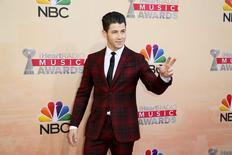 Singer Nick Jonas poses at the 2015 iHeartRadio Music Awards in Los Angeles, California, March 29, 2015. REUTERS/Danny Moloshok