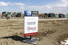 An empty lot ready for a newly built house is for sale in Calgary, Alberta, April 7, 2015.  REUTERS/Todd Korol