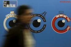 A woman walks past by a banner of Istanbul Film Festival at Atlas movie theatre in Istanbul April 14, 2015. REUTERS/Murad Sezer