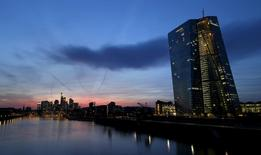 The famous skyline with its banking district (C ) and the new headquarter of the European Central Bank (ECB, R) is pictured in Frankfurt early evening April 13, 2015. REUTERS/Kai Pfaffenbach