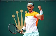 Rafael Nadal of Spain reacts during his match against John Isner of the U.S. at the Monte Carlo Masters in Monaco April 16, 2015.   REUTERS/Eric Gaillard