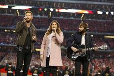Jan 12, 2015; Arlington, TX, USA; Recording artists Lady Antebellum sing the national anthem prior to the game between the Oregon Ducks and the Ohio State Buckeyes in the 2015 CFP National Championship Game at AT&T Stadium. Mandatory Credit: Matthew Emmons-USA TODAY Sports