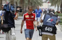 Ferrari Formula One driver Sebastian Vettel of Germany (C) arrives ahead of Bahrain's F1 Grand Prix at Bahrain International Circuit south of Manama, April 16, 2015. REUTERS/Hamad I Mohammed