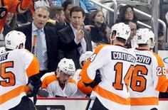 Apr 1, 2015; Pittsburgh, PA, USA; Philadelphia Flyers head coach Craig Berube (top left) gestures as he speaks with his team during a time out against the Pittsburgh Penguins in the third period at the CONSOL Energy Center. Mandatory Credit: Charles LeClaire-USA TODAY Sports