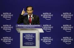 Indonesia's President Joko Widodo gestures as he delivers a speech during the interactive session of the World Economic Forum on East Asia in Jakarta April 20, 2015. REUTERS/Beawiharta
